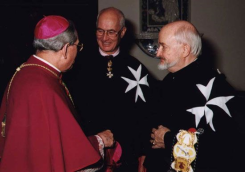 Jesuits wearing huge Maltese cross.