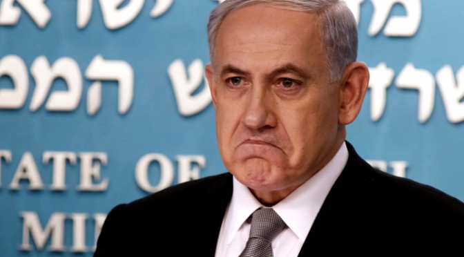 Israel's Prime Minister Benjamin Netanyahu is pictured during a news conference at his office in Jerusalem December 2, 2014. Prime Minister Benjamin Netanyahu sacked his finance and justice ministers on Tuesday, signalling the break up of his bickering coalition and opening the way for early national elections in Israel. REUTERS/Gali Tibbon/Pool (JERUSALEM - Tags: POLITICS TPX IMAGES OF THE DAY)