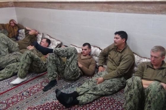 American soldiers rest after release.