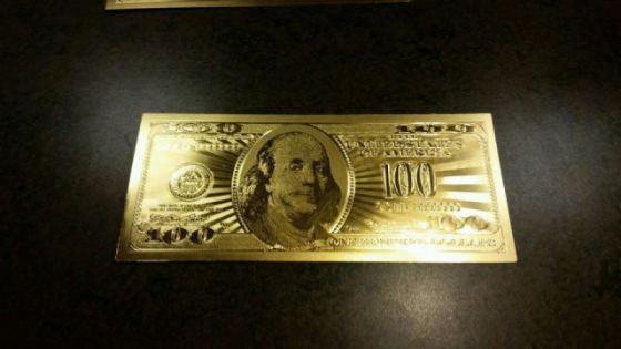 neil-keenan-fake-gold-dollar2