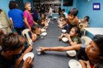 """Street children tuck into freshly cooked """"lugaw"""" at """"Duterte's Kitchen"""", which serves free meals thrice daily from Monday through Saturday, 7am-7pm, at a PDP-Laban building in Cubao, Quezon City. According to Program Director Dexter Araquel, the kitchen was adopted from a similar program of then Mayor Duterte in Davao, and that they hope to expand to other locations nationwide, through the help of volunteers and food donations. (MB Photo by Federico Cruz)"""