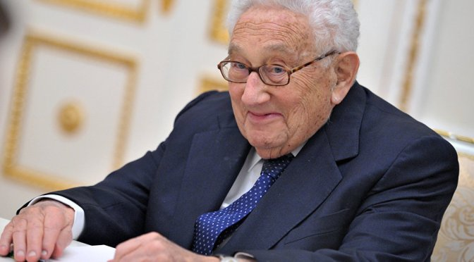 What is Mr. Kissinger up to in Russia?