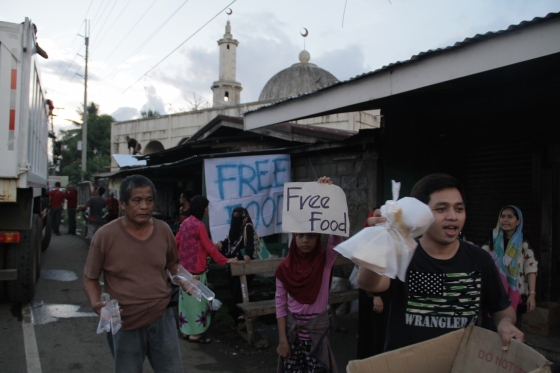 Residents of towns near Marawi offered food to residents fleeing the city