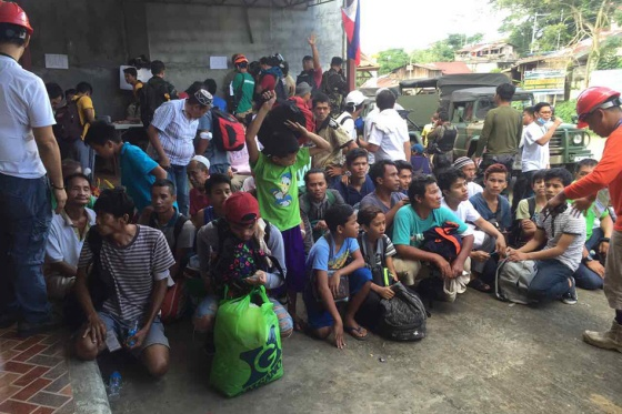 Some of the 144 civilians rescued in a daring dawn operation on Saturday in conflict-stricken Marawi City. Chiara Zambrano, ABS-CBN News
