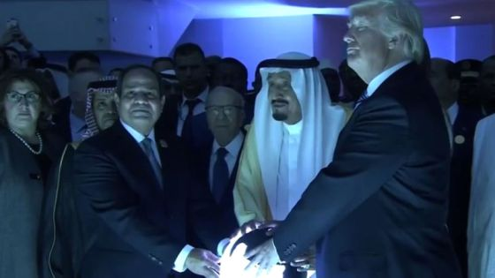 Trump couldn't hide his delight while holding the glowing orb with the biggest clients of the military industrial complex.