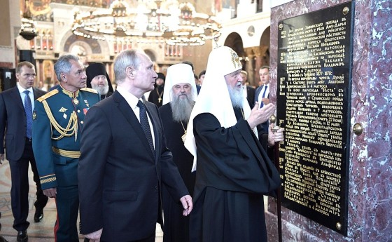 resident Putin tours the Naval Cathedral of St Nicholas with Patriarch Kirill.