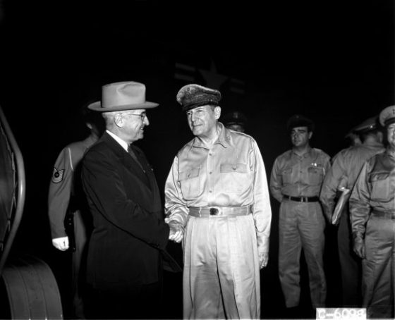 PRESIDENT TRUMAN AND GENERAL OF THE ARMY MACARTHUR CONFERENCE: General of the Army Douglas MacArthur, Commander-in-Chief, UN Command, greeting President Harry S. Truman upon his arrival at Wake Island for their conference.NARA FILE#: 111-SC-353136. Truman and MacArthur on Wake Island, 1950. Photo: Wikimedia Commons