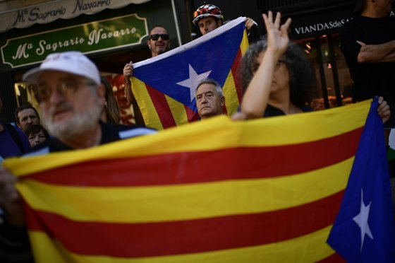 Pro independence trade union worker holds up ''esteleda'' or Catalan pro independence flags, in support of the Catalonia's secession referendum, and against to alleged brutality by police during a referendum on the region's secession from Spain that left hundreds of people injured, in Pamplona, northern Spain