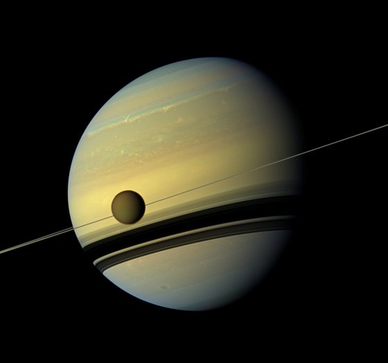 Saturn and its Titan Moon © AP Photo NASA