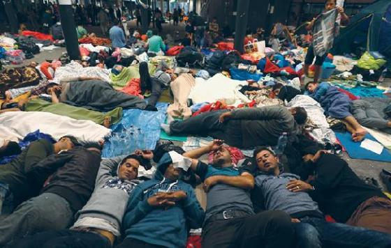Syrian refugees resting on the floor of the Keleti railway station in Budapest, Hungary, Sept. 5, 2015.