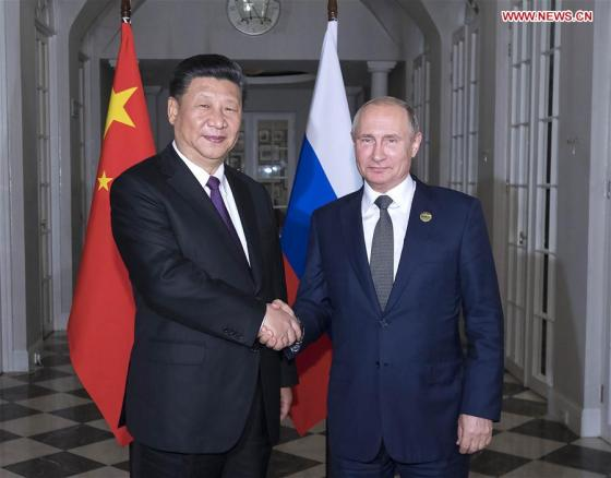 "OHANNESBURG, July 26 (Xinhua) -- Chinese President Xi Jinping and his Russian counterpart, Vladimir Putin, met here on Thursday and exchanged in-depth views on current international situation. The two heads of state held a meeting and also had dinner together on the sidelines of the 10th BRICS summit in Johannesburg, South Africa. During the meeting, they also touched upon major issues of common concern. The 10th BRICS summit is running from Wednesday to Friday under the theme of ""BRICS in Africa: Collaboration for Inclusive Growth and Shared Prosperity in the Fourth Industrial Revolution."""