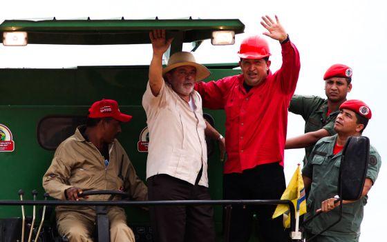Hugo Chavez and Luiz Inacio Lula da Silva visit a soy farm in El Tigre in Venezuela's Anzoategui state, Oct. 30, 2009. Ariana Cubillos   AP